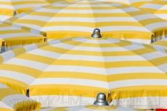sonne,sommer,nahaufnahme,details von sonnenschirmen,farbig,bunt,stoff
